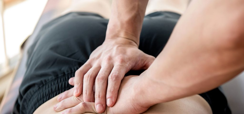 patient receiving lower back massage