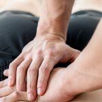 patient receiving lower back massage